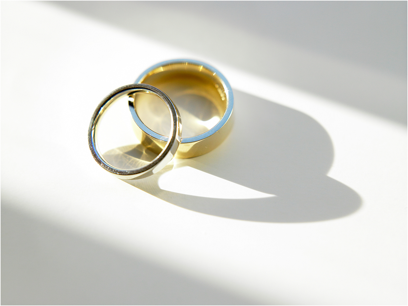 The rings in this shot were placed on a bit of white paper on a windowsill in direct sunlight. Simple but effective composition with shadows. Remember to ask the best man for the rings early on before you really get busy. ISO 400 f/5.6 at 1/250th