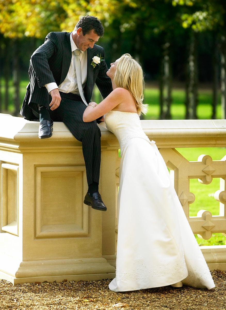 I asked the groom to hop up on the pillar and I shot this frame into the light. Be dynamic with your posing and great pictures will result. ISO 400 f/4 at 1/500th