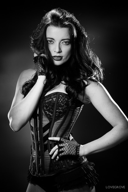 Helen Diaz in a corset by Lisa Keating. Lit in a classic style.