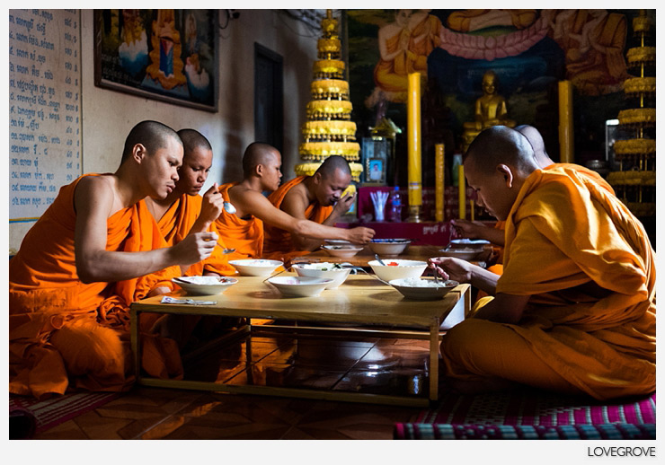 Buddhist monks having lunch. They are only allowed to eat what they have been given.