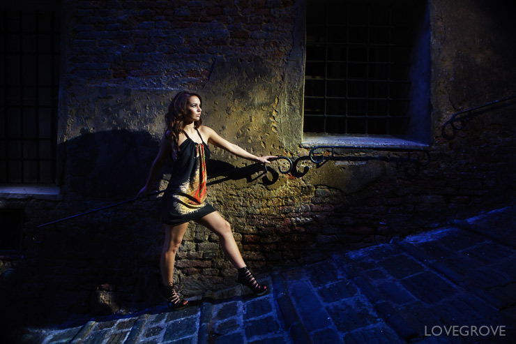 05. Lisa Marie on the steep steps in Sienna that lead up to the Piazza Del Campo. A single Speedlight with a full CTO gel is the keylight. The blue is provided by the fading daylight.